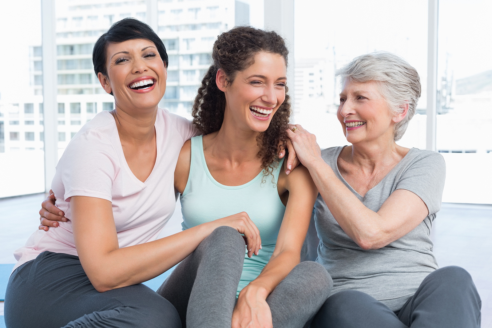Three women supporting each other